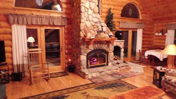 Saint Helen cabin rental - The Gathering Room includes kitchen, dining, living room, TV, fireplace, views.