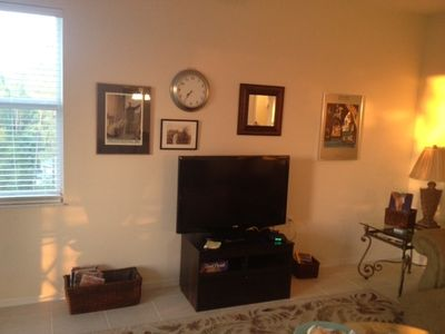 Comfortable living room with 2 couches and a new flat screen TV and DVD player