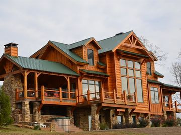 Greers Ferry Lake lodge rental - this home has 3 stories, 5 bedrooms, 5 and a half baths