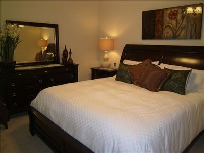 Master Bedroom with Wall Mounted Flat Screen TV and Ensuite