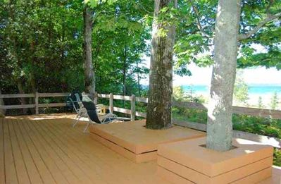New spacious deck spans front of cottage looking over Bay
