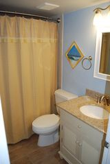 Redington Shores condo photo - The guest bath, directly off the guestroom, has new floor, fixtures & vanity.