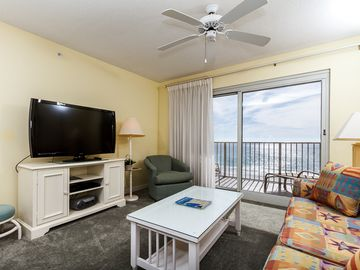 Fort Walton Beach condo rental - The window to the balcony in this room has white sheer curtains, - The window to the balcony in this room has white sheer curtains, producing a bright living area.