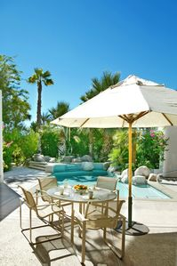 Relax poolside with cocktails and al fresco dining
