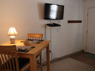 Kitchen table, HDTV & DVD - Boardwalk condo vacation rental photo