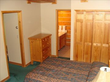 Downstairs Bedroom with Dresser, Large Closet and attached Full Bathroom