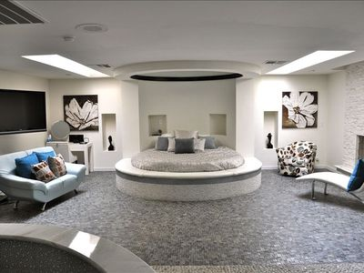Master Bedroom with round bed and mirror on ceiling.