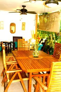 Teak dining table on our spacious lanai
