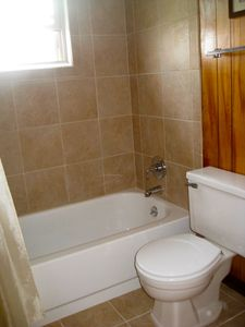 Two newly tiled full bathrooms, both with shower windows w/ water view