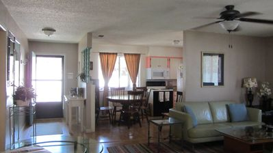 Spacious, open living and dining room with large front entry way.