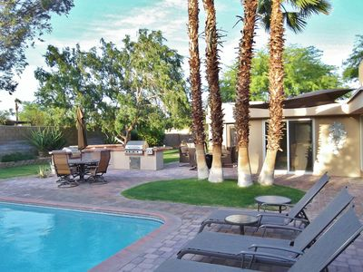 Outdoor living at its best. Shade trees, pavers, huge pool, and 3 seating areas.