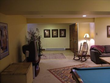 Large mud room and recreation room with TV and pool table