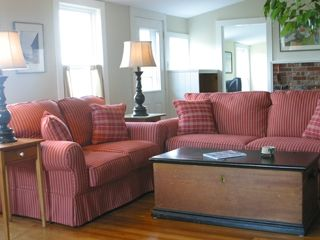 Port Clyde cottage photo - Living Room has multiple ocean views, large flat screen TV.