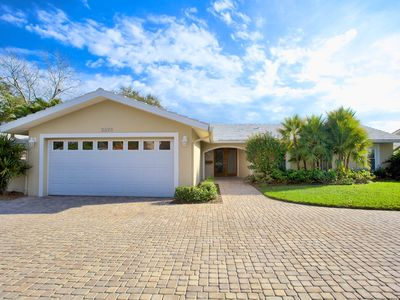 Your home away from home awaits! Beautiful landscaping and circular driveway