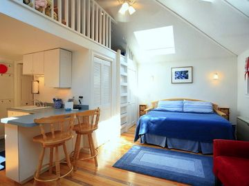 Rockport cottage rental - Master bedroom and living room with views of the Teddy Bear Loft and the kitchen