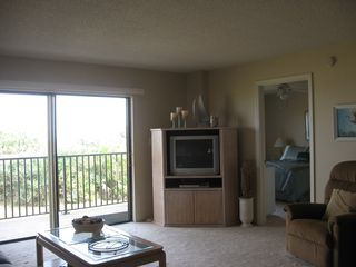 Ormond Beach condo photo - Spacious living area looks out to the ocean