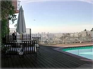 Deck with view, large pool, jacuzzi, gas grill and elegant patio furmiture