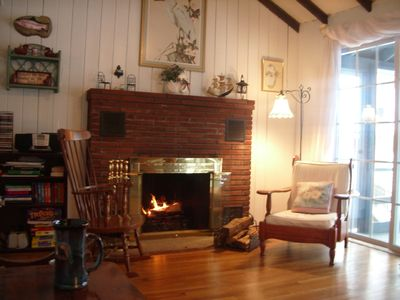Cozy up to the fireplace in our living room & enjoy the lake-view.