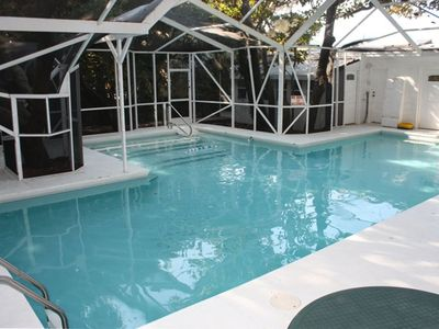 T-shaped 40 x 31 ft. screened pool heated year-round to up to 90 degrees F.