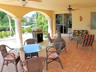 Tavernier villa photo - OUTDOORS; LIVING ROOM & DINING ROOM AREA W/BBQ TOWARDS WATERWAY VIEW