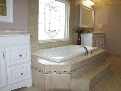 Upstairs bath has an extra large soaking tub and huge walk-in shower.