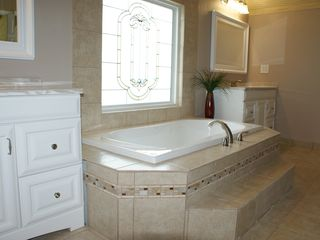 Milam lodge photo - Upstairs bath has an extra large soaking tub and huge walk-in shower.