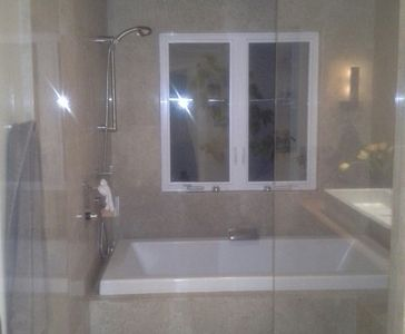 Wetroom that includes steam shower w/2 heads and large tub. Piped in music