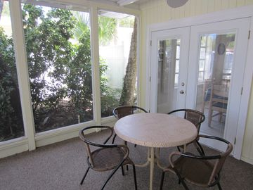 Large screened-in porch is great for lunches after the beach or pool.