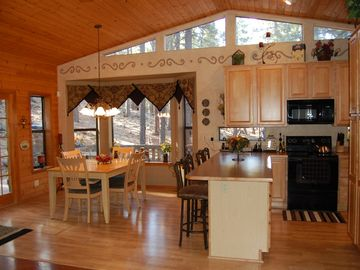 Dining room and kitchen; great views