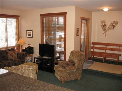 Fernie townhome rental - Living Room & Entry area with walkout to Deck and BBQ