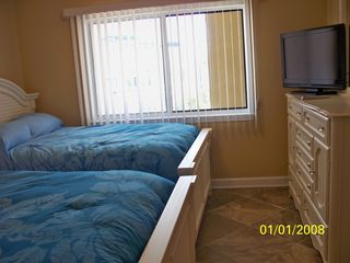 Oceans Mist Ocean City condo photo - Bedroom 2 with 2 full beds, and a flat screen tv attaches to private bath.
