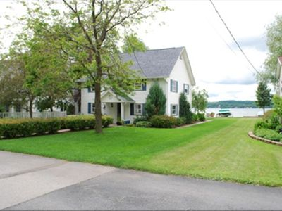 Charming Year-Round, Level Lakefront Home on Sandy Beach!