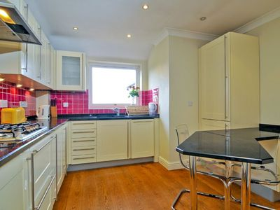 Fully equipped kitchen with kitchen table and nice lighting