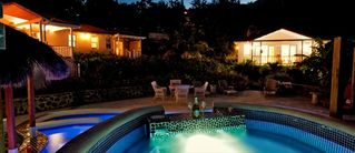 Cap Estate villa photo - Hot Tub, Pool and Villa View at Night from Jacuzzi Hot Tub. Champagne Anyone?