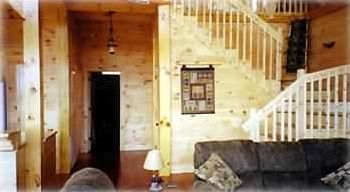 """Knotty White Pine, With Huge Beams and Wood Thru Out Cabin"""