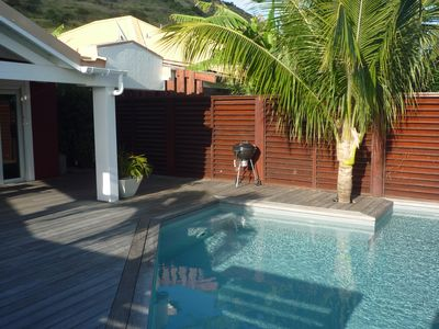 The private swimming pool and barbecue grill.