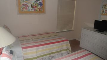 Twin Bedroom With LCD TV