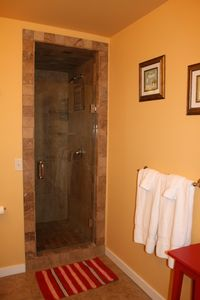 Walk-in tiled shower built for two.