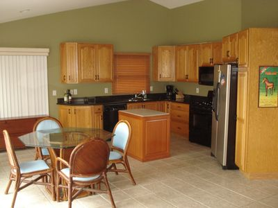 Kitchen with the small dining table.(Larger table available seats 8)