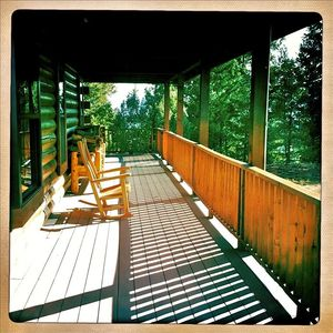 Pagosa Springs house rental - Morning coffee on the porch. 7 matching rocking chairs.