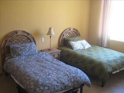 Second bedroom with double and single beds