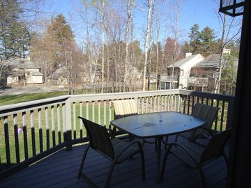 large new deck with screened in porch below