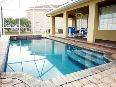 Fully screened pool set in peaceful landscaped surroundings