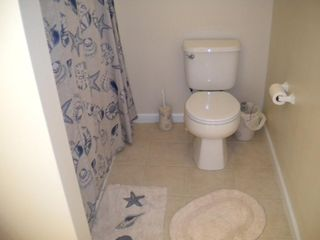Master bathroom, seashell theme. - Wildwood condo vacation rental photo