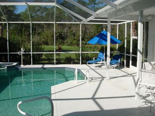 East Naples house photo - Screened Lanai with Pool, Lounge Chairs and 2 Outdoor Eating Areas
