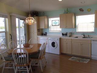 Hutchinson Island house photo - different view of sunny kitchen and front-loading washer & dryer
