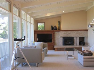 Enjoy the luxurious living room with panoramic views, gas fireplace, large HD TV