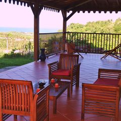 Le Marin villa photo - One aisle of the veranda