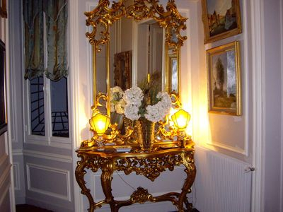 Italian gold leaf console located in the entry gallery