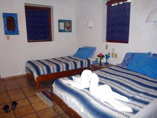 """Tigres"" bedroom has double & single bed, walled terrace & A/C--great for kids! - Playa del Carmen villa vacation rental photo"